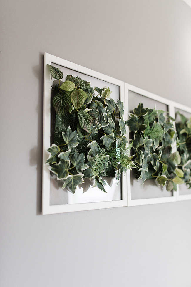 close of up of faux greenery wall hanging
