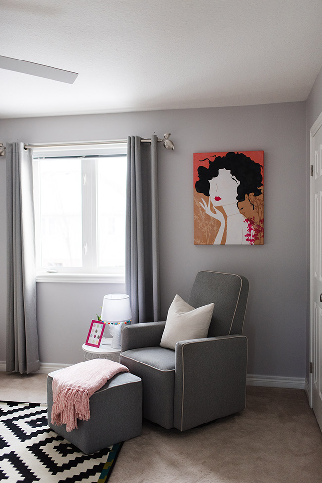 Breastfeeding area with a grey glider and night stand