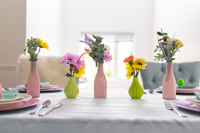 Woman putting together her DIY floral Spring centerpiece