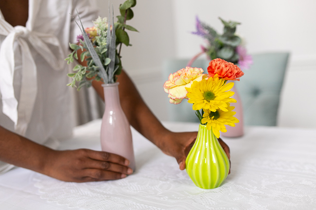 woman putting together her DIY Spring centerpiece