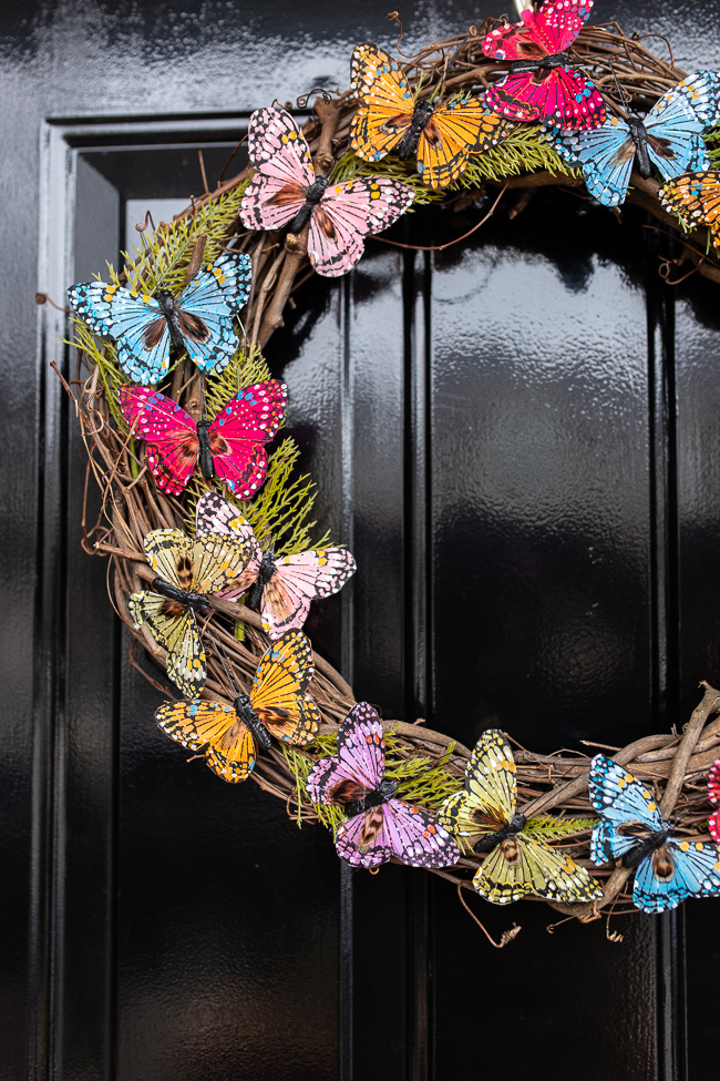 A close up of a butterfly wreath