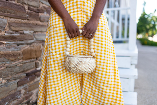 woman holding her handmade straw basket bag