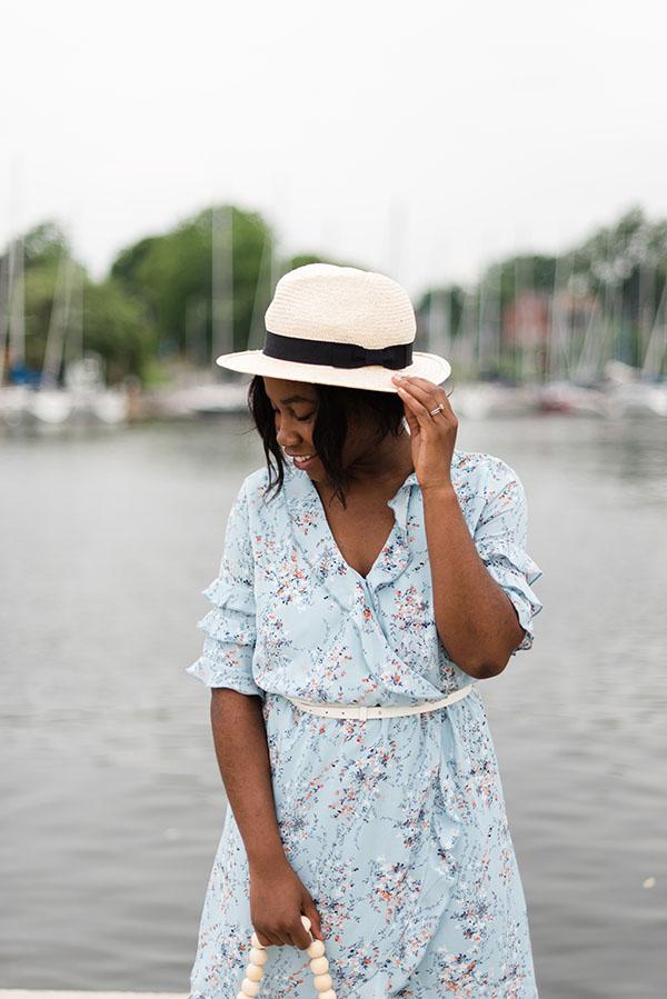 woman wearing a light blue tear dress